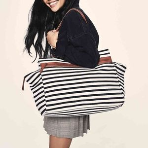 DSW travel bag black white striped leather trim